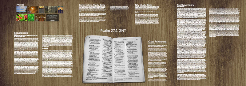 An open Bible appears in the middle of a desk with holographic text around it.