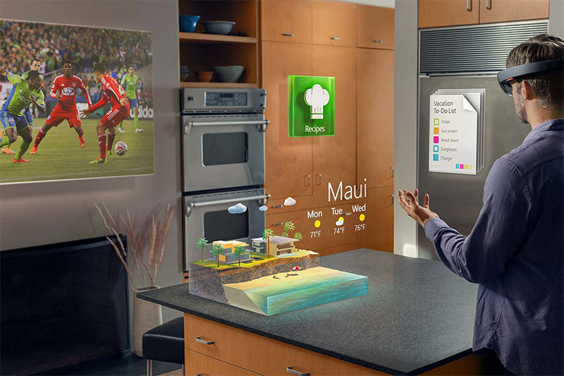A man is wearing HoloLens in his kitchen.