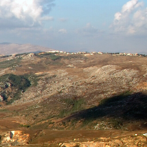 panorama looking north of Marjaayoun, which is just visible at the top of the hill