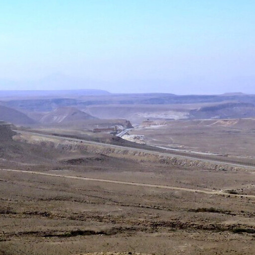 panorama looking southwest including Mesudat Ein Qedeis, which is at the light area by the road at center