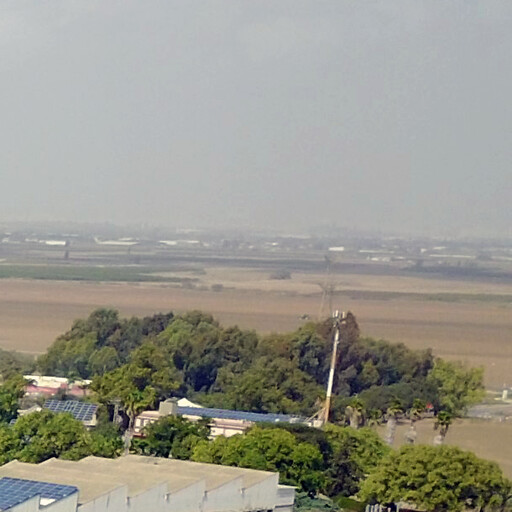 panorama of a region including Tell as Sawafir, which is just visible in the distance on the right