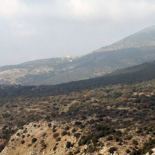 panorama of mountains including Khirbet Mezara in the cloud shadow at center