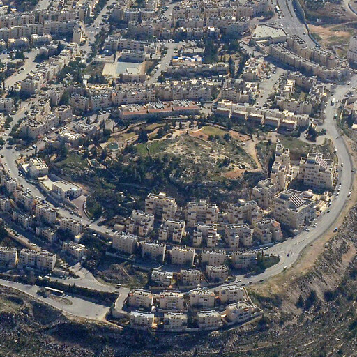 aerial panorama of Ras et Tawil, which is on the summit of the hill at center right