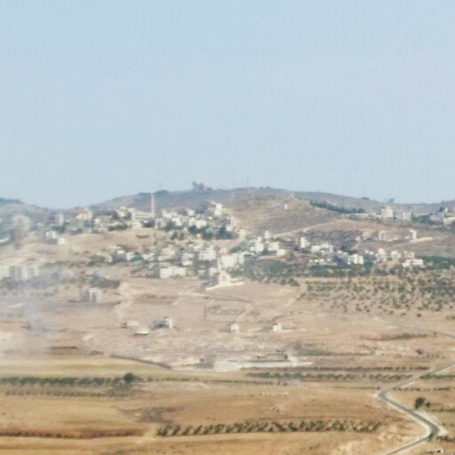 panorama looking north including Ras ez Zemara, which is behind the buildings at center
