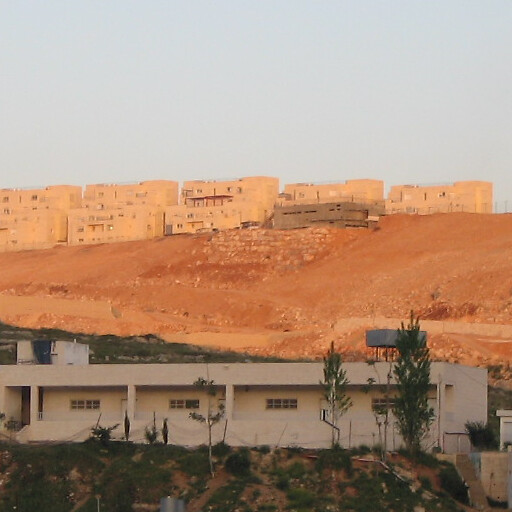 cityscape including Khirbet Khamasa on the hill at center