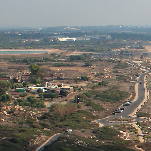 panorama looking south of an area including Khirbet el Musheirifeh, which is by the center to the left of the road