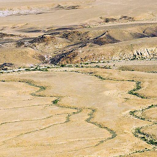 panorama of Wadi er Rummun, which runs horizontally by the bottom
