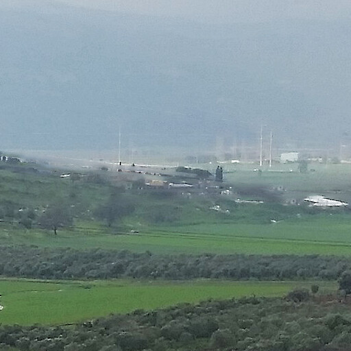 panorama including Khirbet Ibtin, which is at the base of the hill at center