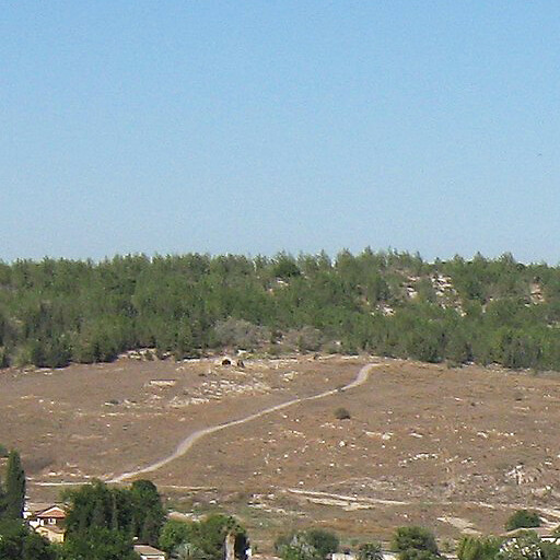 panorama looking west of a region including Khirbet Umm Jina, which is visible by the path going up the hill in the distance